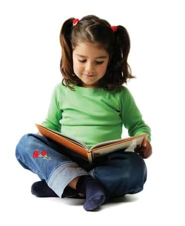 Little Girl Enjoying a Book